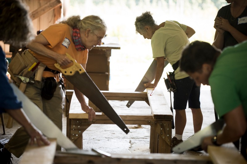 Women sawing wood